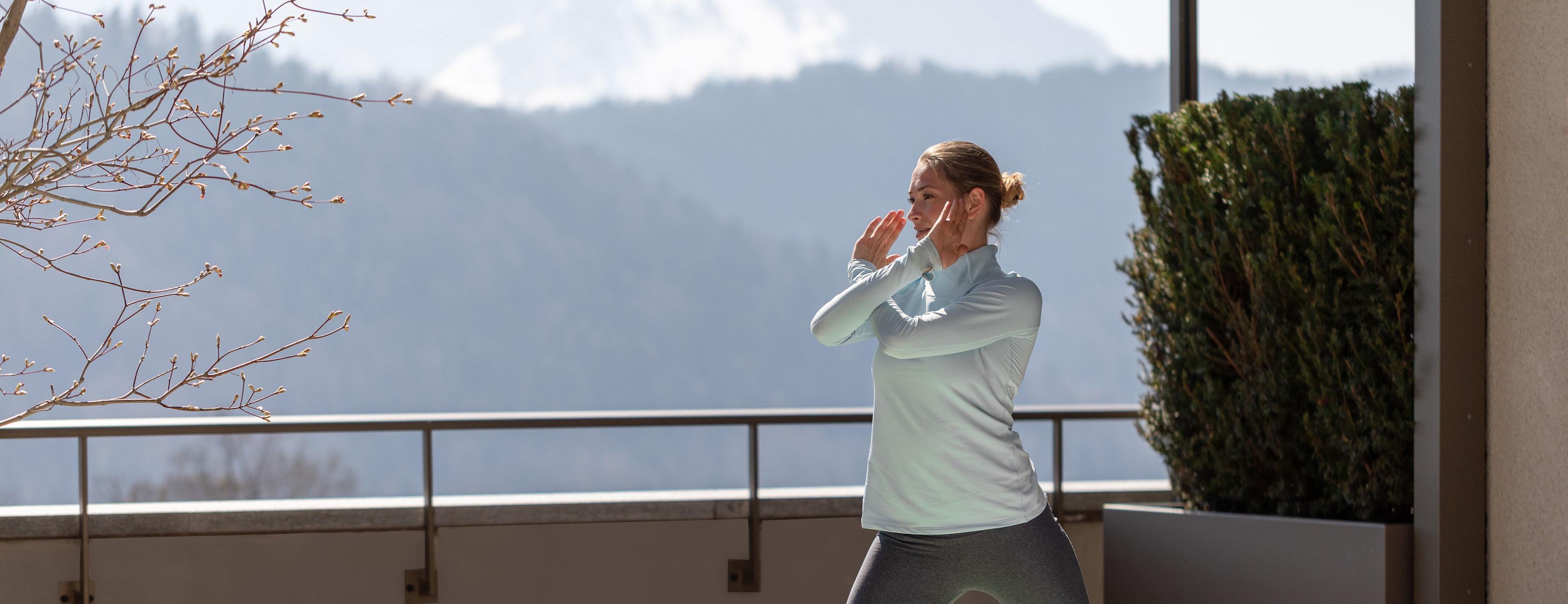 Yoga exercises on the balcony