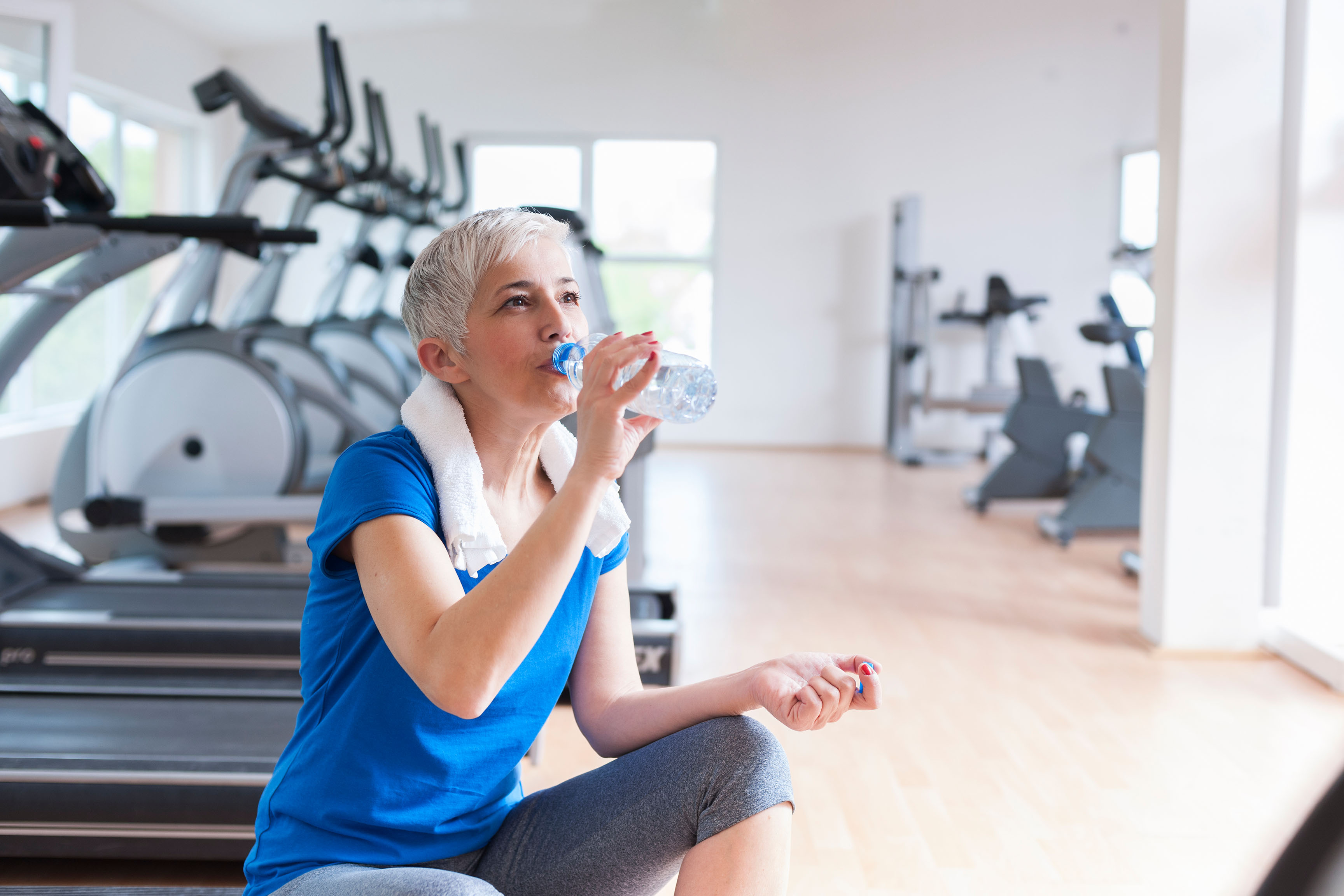 Patient drinking water in fitness room