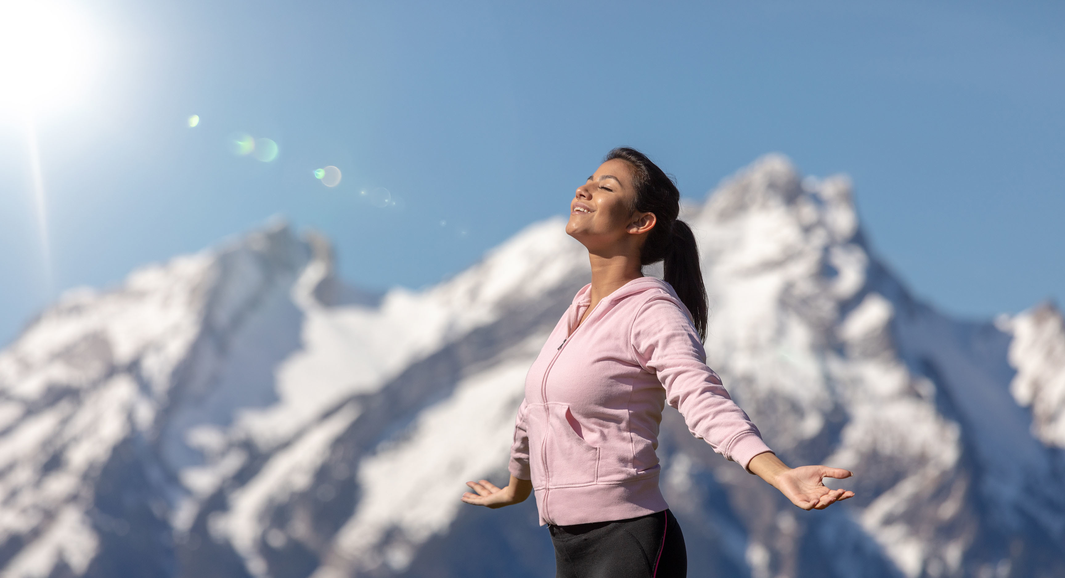 Woman enjoy sun in the Alps
